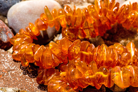 Amber necklace on a beach of the Baltic Sea  Stock Photo