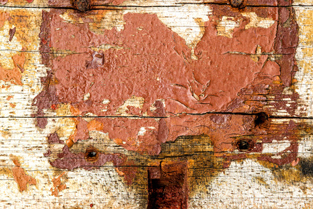 old plank with chipped color remains