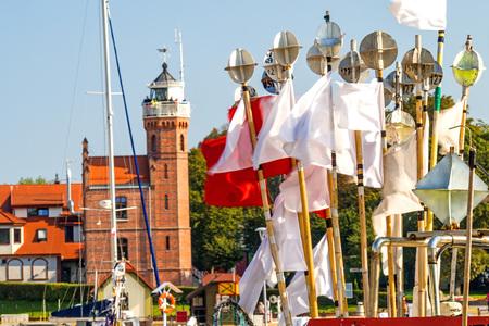 trawler net: Fishing port of Ustka, Poland with old lighthouse