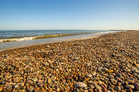 lonesome beach of the Baltic Sea with blue sky Stock fotó