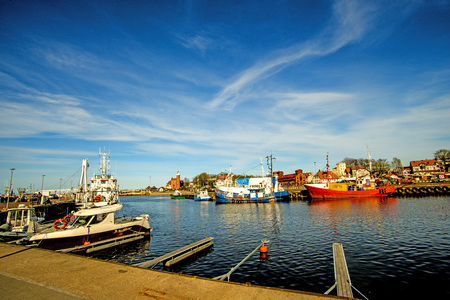 Fishing port of Ustka with old lighthouse Standard-Bild - 103247806