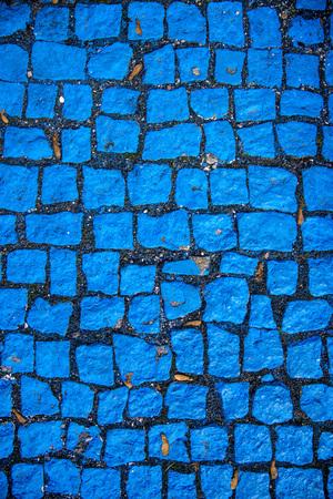 blue painted cobblestones, parking for handicapped