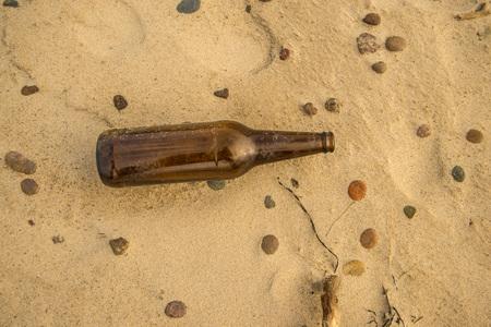 beer bottle on a beach