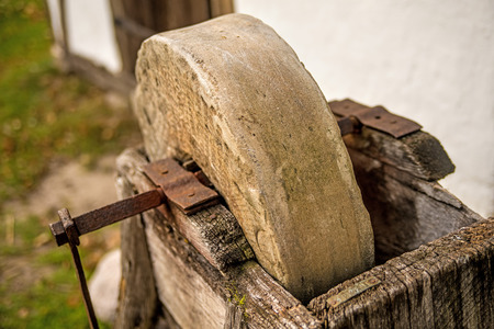 old rotary grindstone at a country house Standard-Bild - 119602921