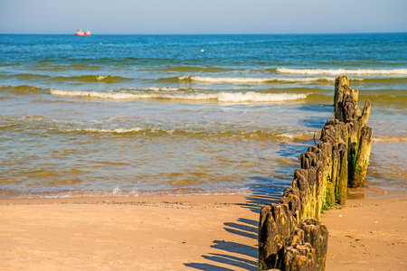 old groins in the Baltic Sea with blue sky Stock Photo