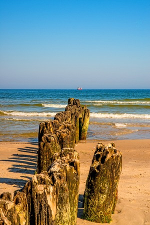 old groins in the Baltic Sea with blue sky