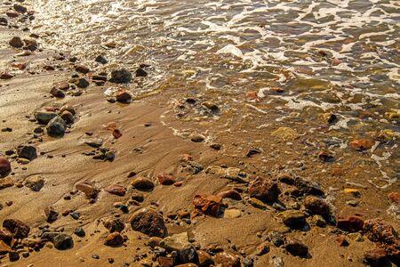 surf of the Balti sea on pebbles