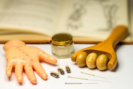 acupuncture needles with hand model and chinese medicine tools