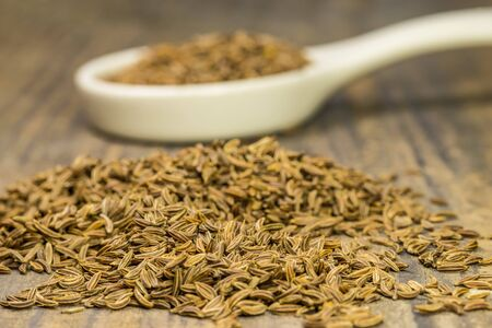 Caraway, spice and medicine on a spoon