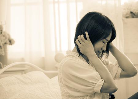 Tormented woman in bedroom