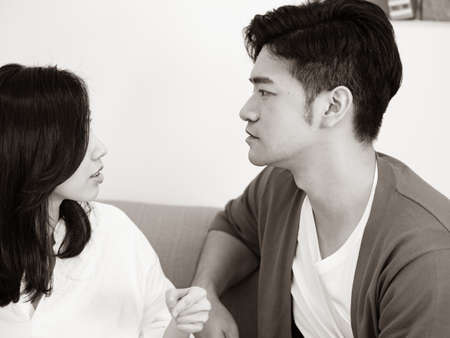 Young woman and man Have Disagreement in black and white