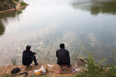 beside: mens fishing beside the lake
