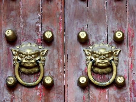 Old chinese door ornament , lion door knockers photo