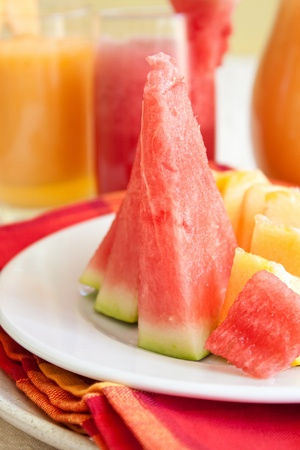 Watermelon and melon slices like salad in summer day photo