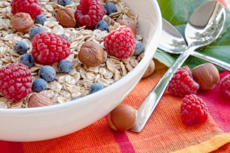 dietary fiber: Oat nuts with fresh blueberries and raspberries and hazelnuts