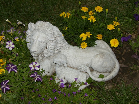 lion and lamb: lion and lamb statue in flowers
