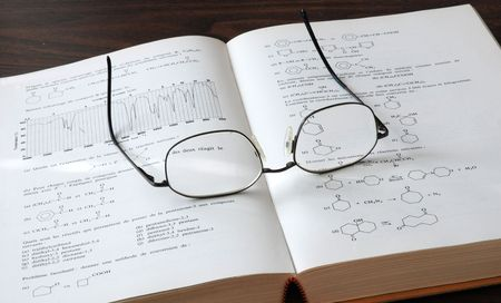 chemistry book and eyesglass