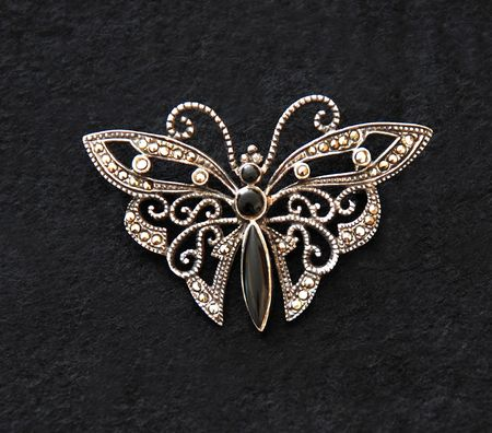 silver butterfly mounted in brooch Imagens