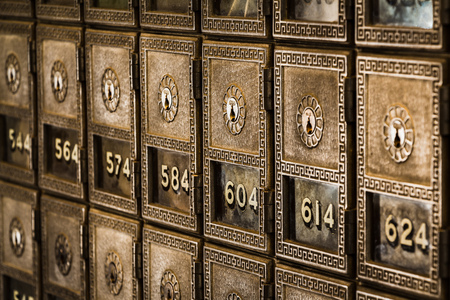Rows of Old-Fashioned Post Office Boxes Stock Photo
