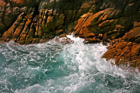 Waves crashing into rocy shore
