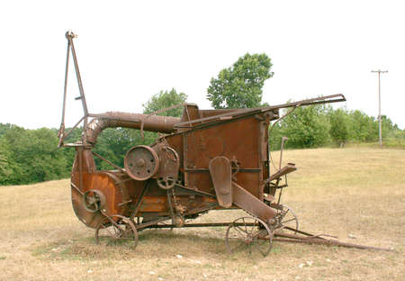 construction machinery: antique corn husker at least 100 years old