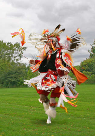 native american man: A young Native American in a war dance
