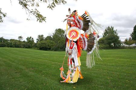 regalia: A young Native American  in war dance costume