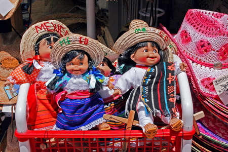 Several colorful Mexican dolls
