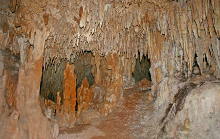 Stalactites and Stalagmites and a Cenote in Aktun Chen, Mexico