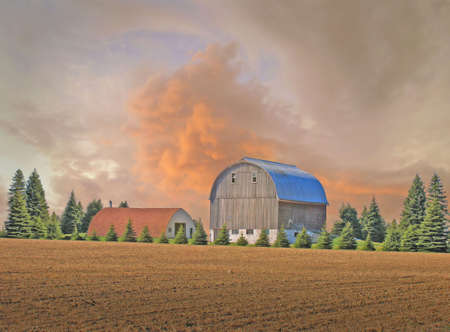 An incoming strom and a barn and field         photo