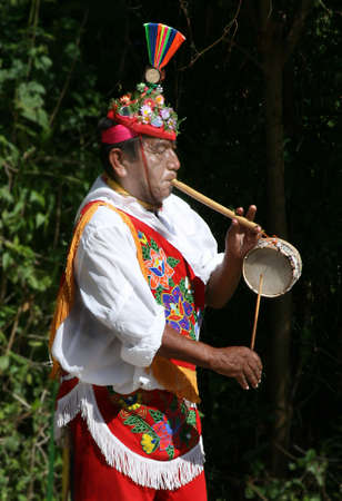 a voladoro playing flute and drum Stock Photo