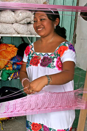 A Mayan Mexican weaving a hammock Stock Photo