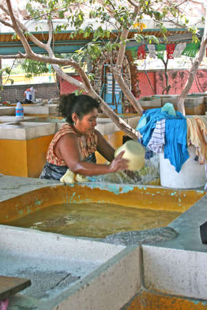 handwash: Mexican women doing hand washing in sinks in Alcapulco, Mexico Stock Photo