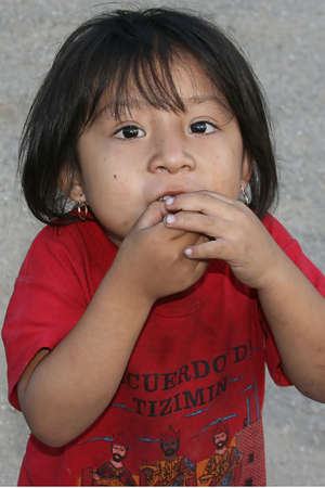 a child begging at a tourist site in Mexico