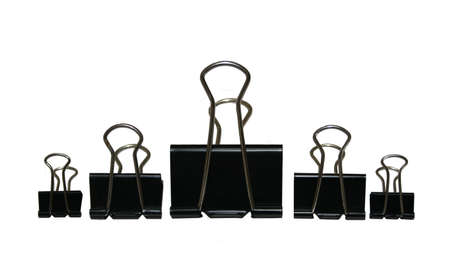 an assortment of black binder or paper clips