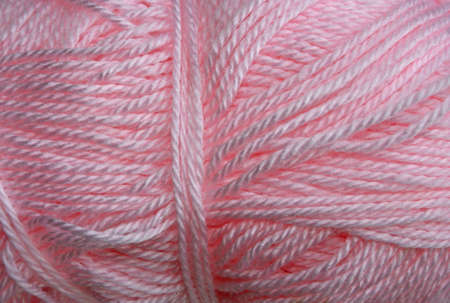 acrylic yarn: a skein of acrylic pink lightweight yarn Stock Photo