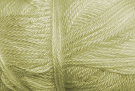 acrylic yarn: a skein of acrylic yellow light weight yarn