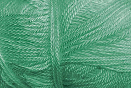 acrylic yarn: a skein of acrylic green lightweight yarn Stock Photo