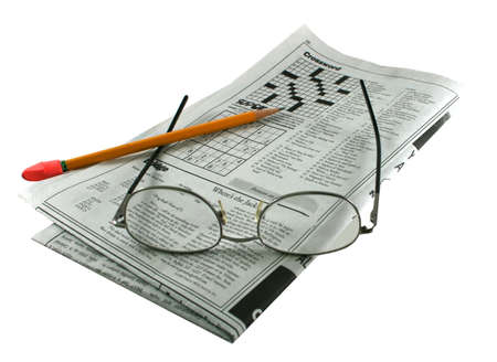 hand writing: newspaper puzzles, eyeglasses and pencil on an isolated background