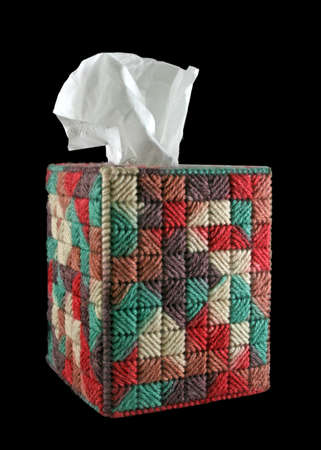 a handmade yarn tissue box cover and tissue on isolated background