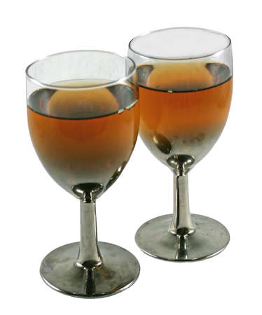two glasses filled with brandy wine on isolated background 写真素材