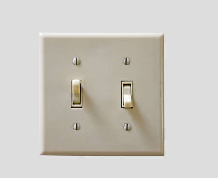 a double-toggle light switch on an isolated background