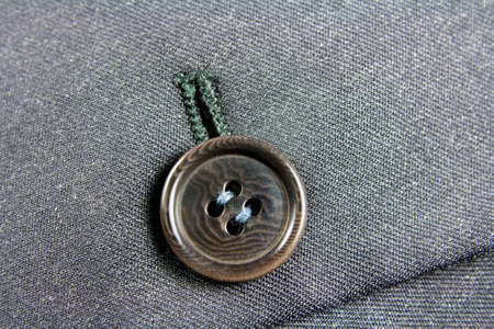buttonhole: a button and buttonhole on a suit jacket Stock Photo
