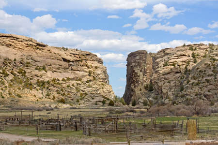 A landmark to the pioneers moving west in their wagons with a ranch in the foreground