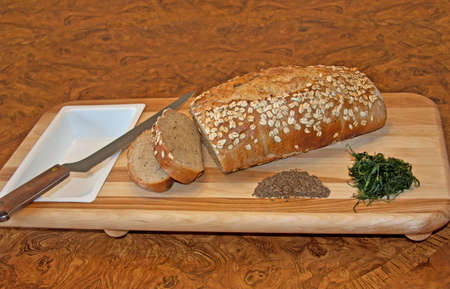 a loaf of rye bread with dill and caraway seeds photo