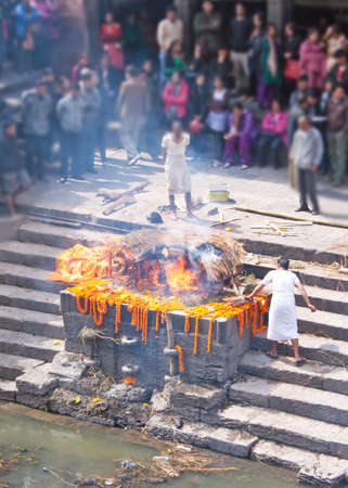 A creamation on a ghat in Nepal