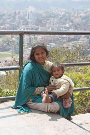 a Nepalese woman and baby begging in Nepal