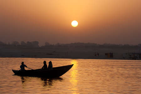 Boat on the Ganges River at Sunrise, Varanasi, India photo