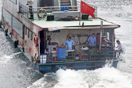 Cooks on the back of a Chinese sightseeing boat on Li River Editorial