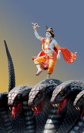 Lord Krishna dancing on a multi-headed snake god